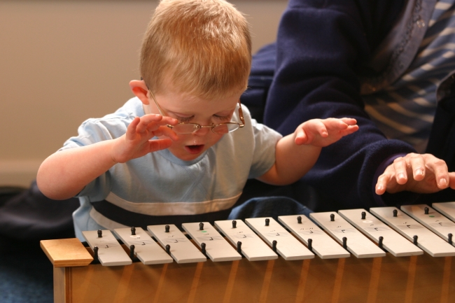 Picture of a boy playing a xylophone