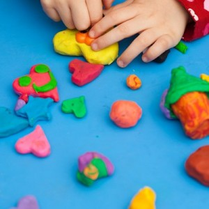 Child using play doh in play therapy